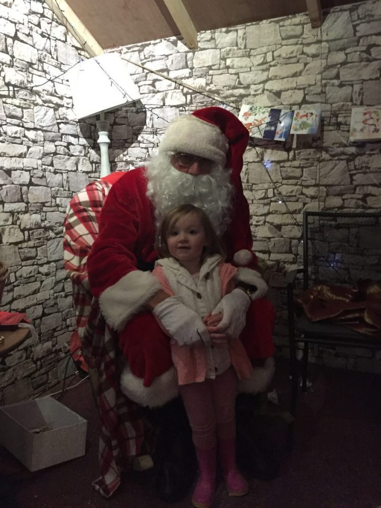 Santa and Mia at Santa's grotto