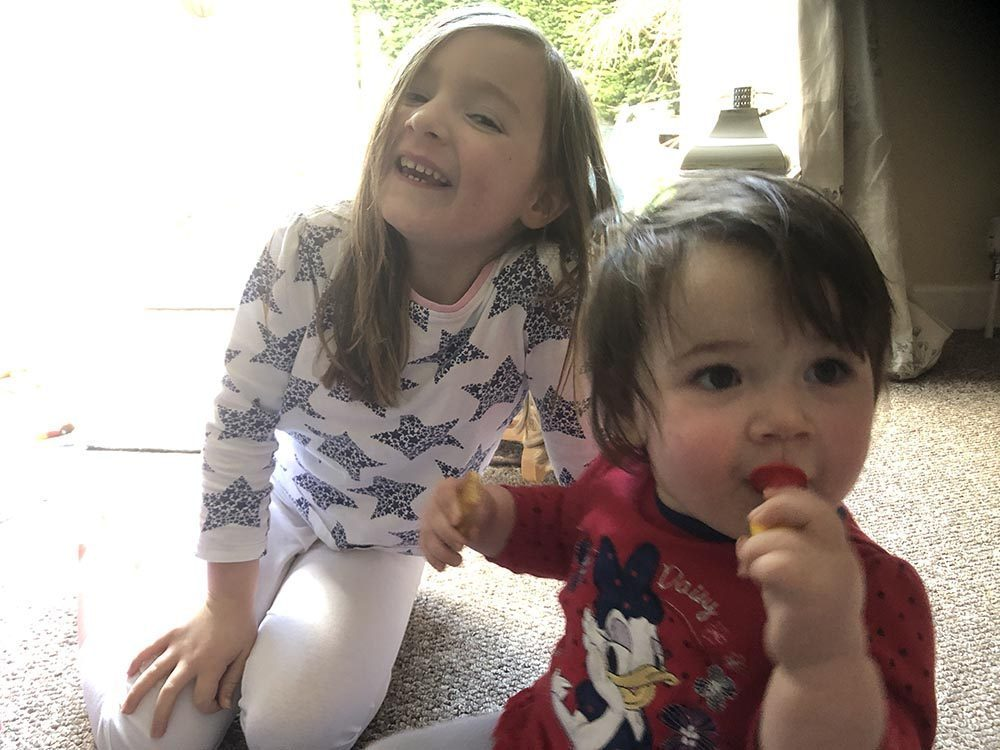 Lottie and Mia sat together smiling