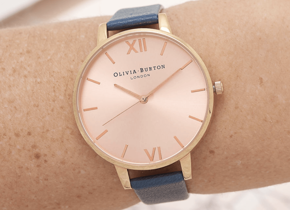 Rose gold watch with navy blue stap