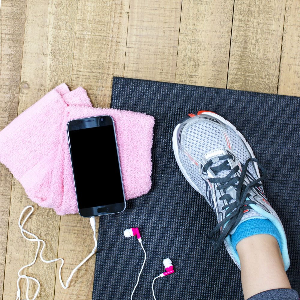 Exercise mat, Trainer, Phone, and pink flannel