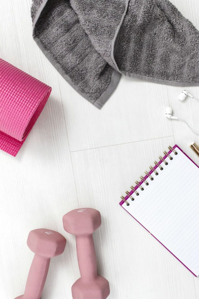 Pink dumbells, Pink mat, grey flannel and notebook