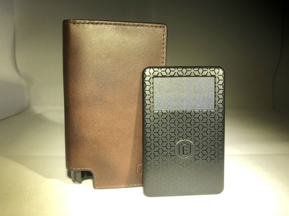Brown leather wallet with black slim tracking card