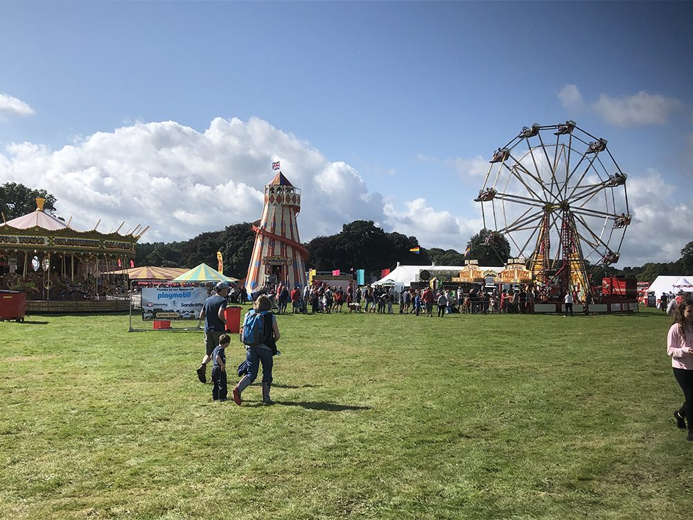 Fairground with ferris wheel, helter skelter and carousel