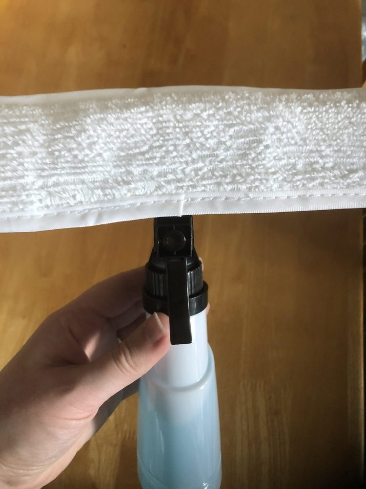 Microfibre cloth attached to the bottle