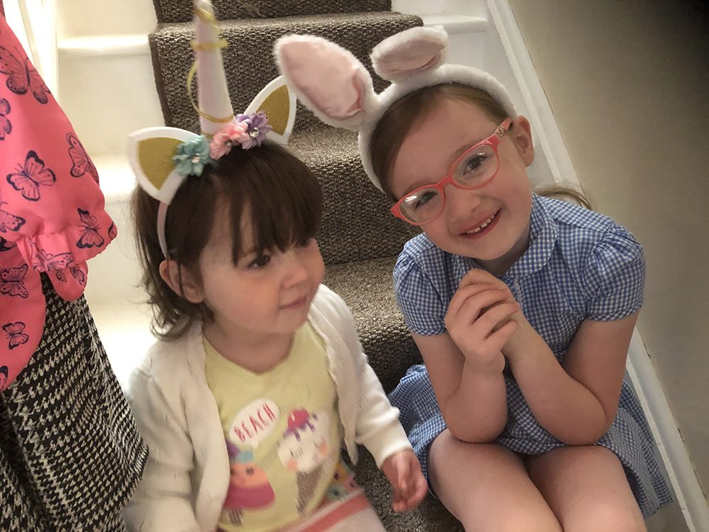 Lottie and Mia with bunny ears and unicorn headbands on