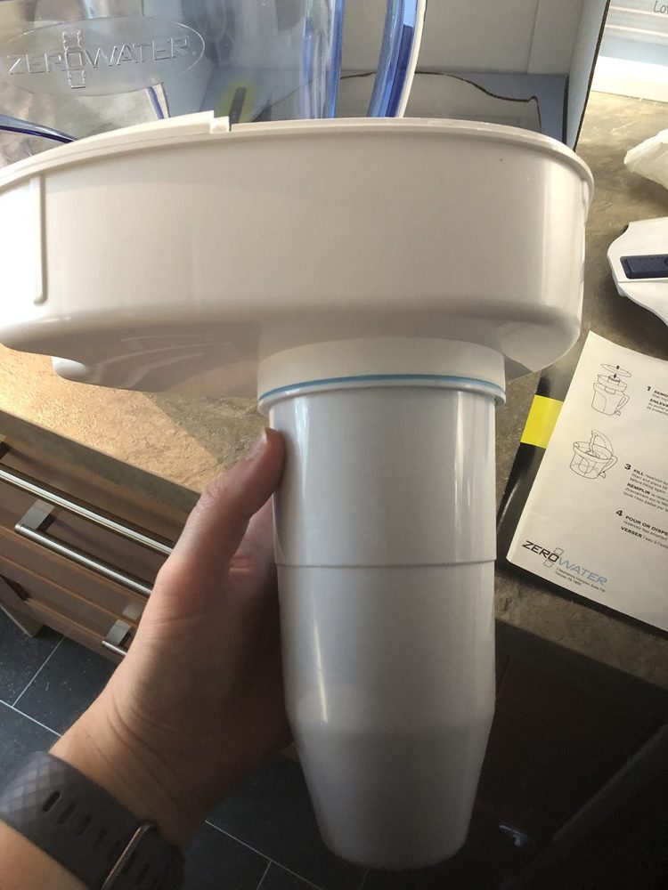 ZeroWaste Water Filter connected to the lid