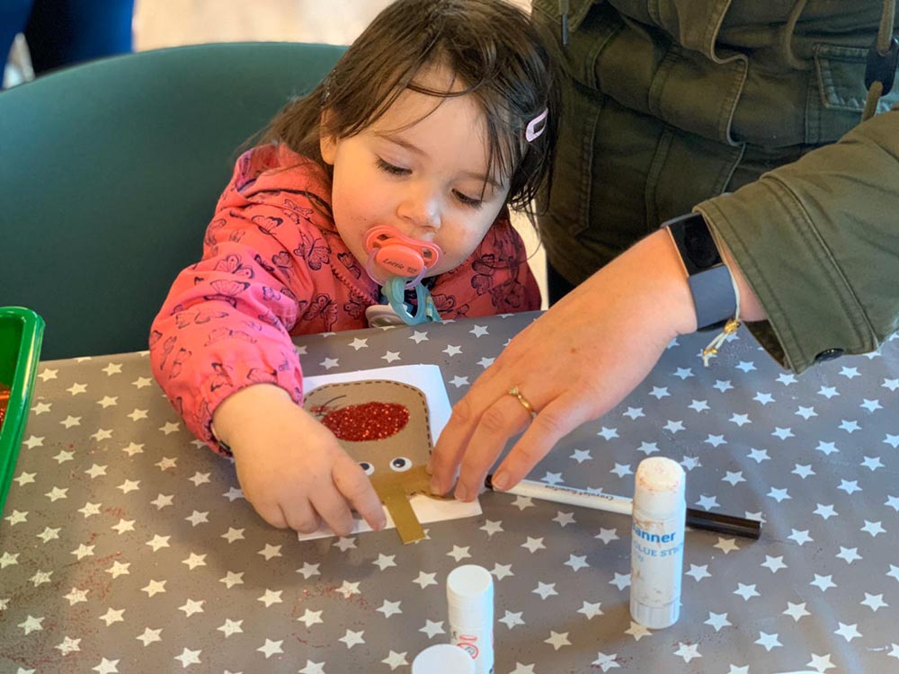 Lottie making a glittery card