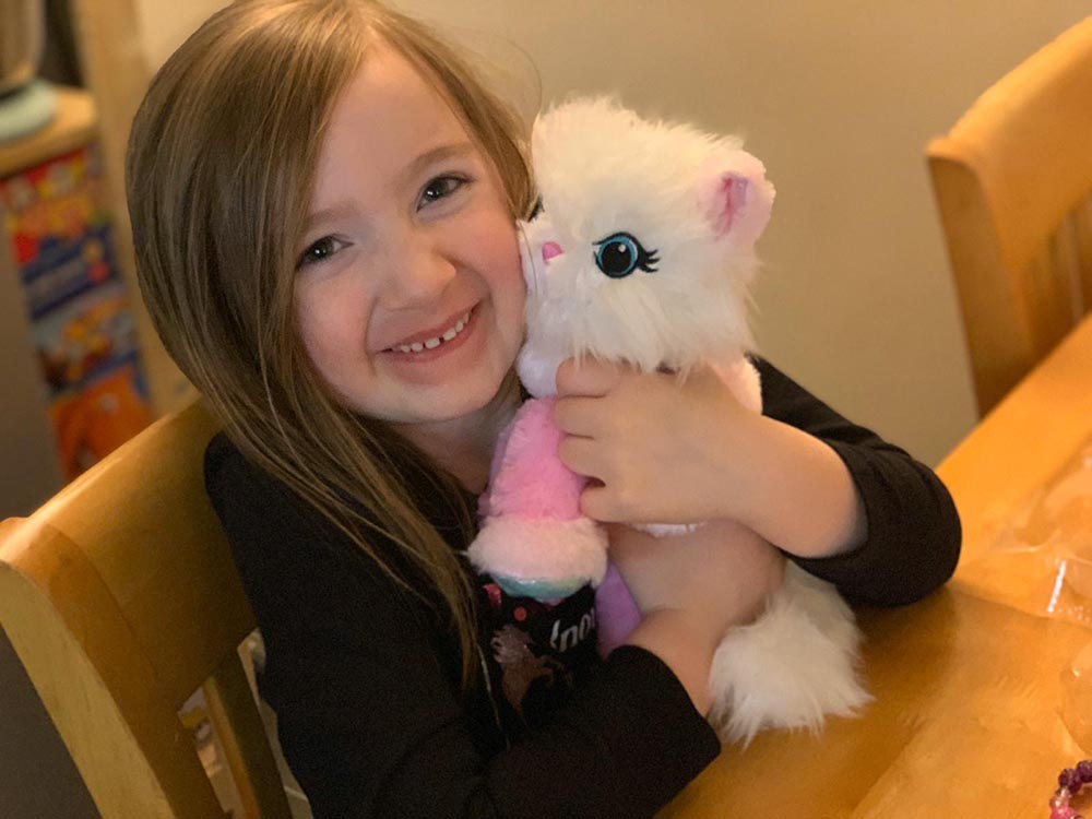 Mia with her Purella Kitty plushie