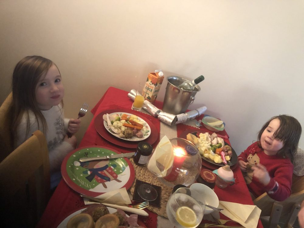 Mia and Lottie sat eating Christmas dinner