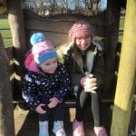 Mia and Lottie on the playground