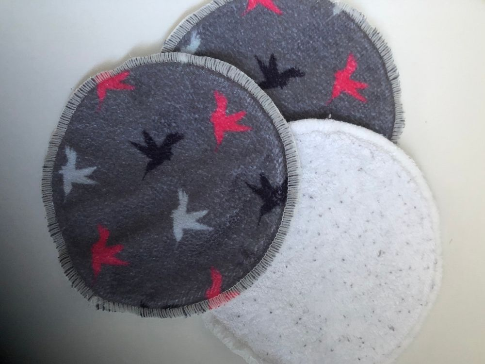 3 grey cloth face pads with pink, black and white bird design