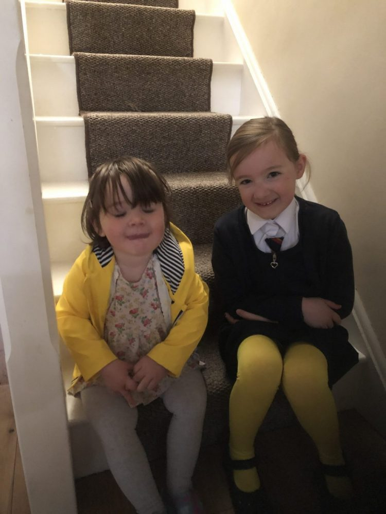 Girls sat on the stairs ready for school