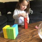 Lottie building a Geomag block tower