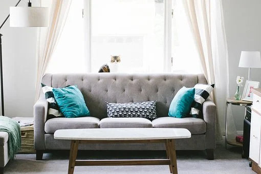 Grey sofa with blue cushions