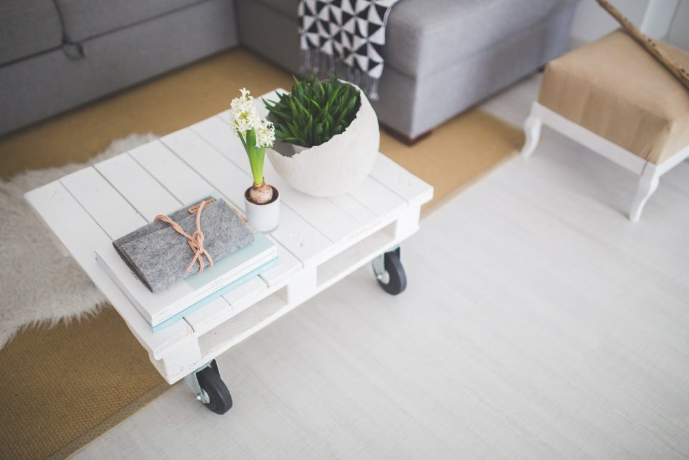 white coffee table with plants on it