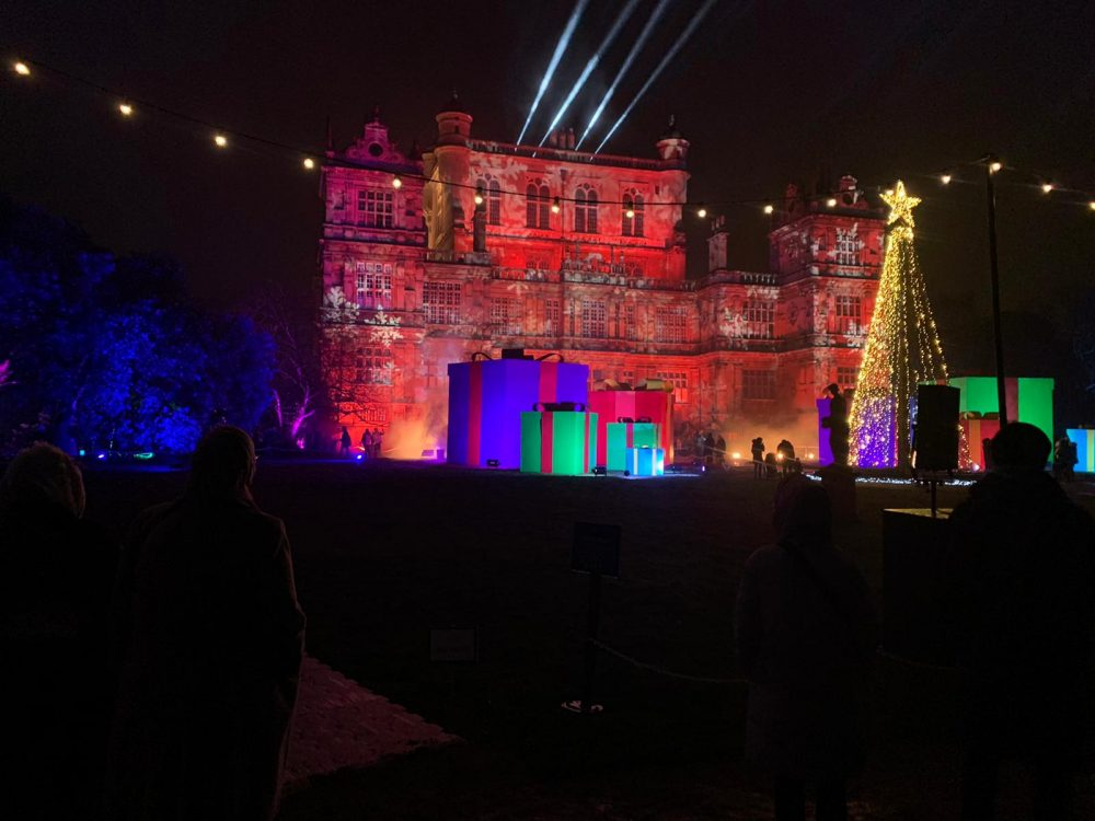 Wollaton Hall lit up with coloured lights