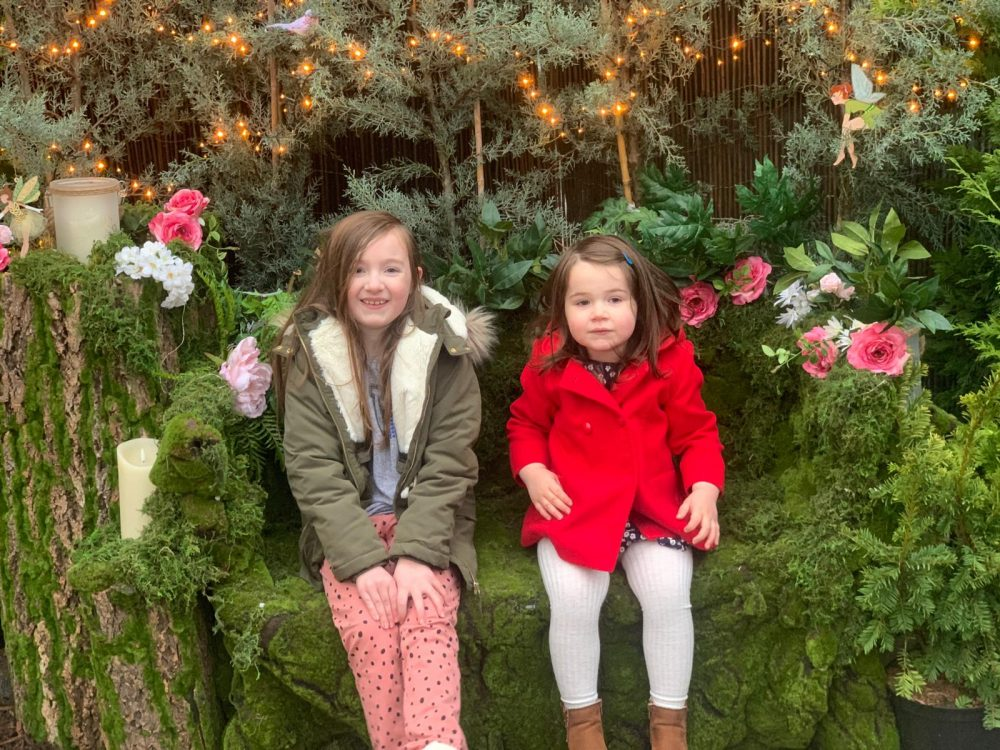 Lottie and Mia sat on a bench
