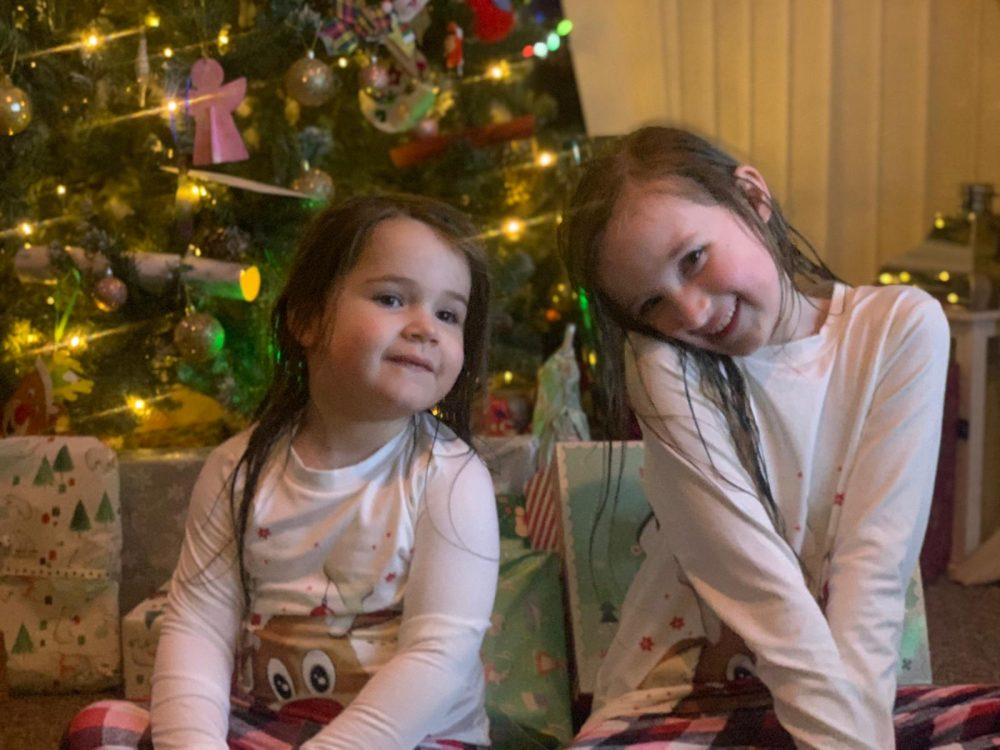 Girls by the Christmas tree - Christmas and New Year's 2020