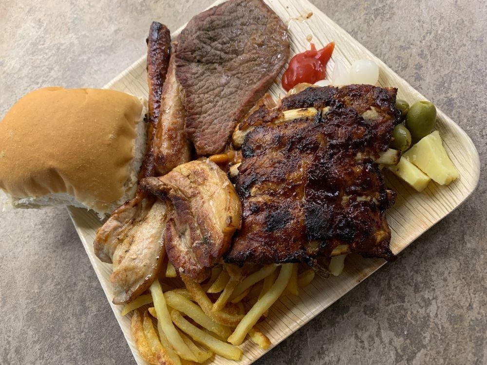 BBQ food on palm leaf plate