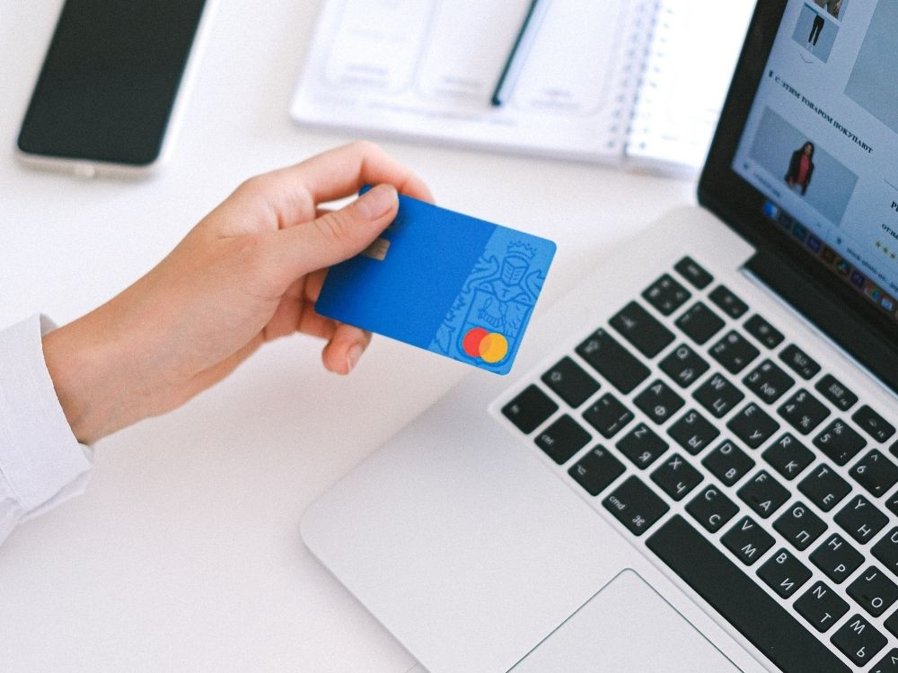 Mac and blue bank card