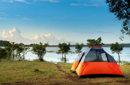 Camping tent next to water