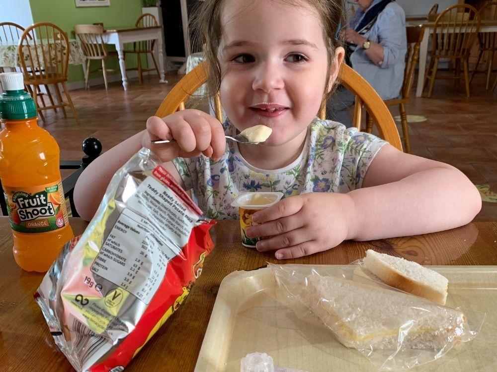 Lottie eating a yoghurt