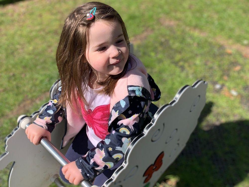 Lottie sat on a play area