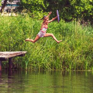 Child jumping into river