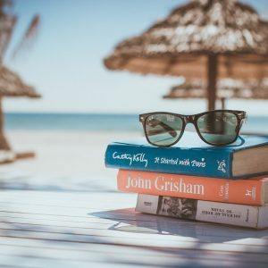 Book with sunglasses on top