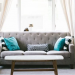 Grey sofa with blue cushions